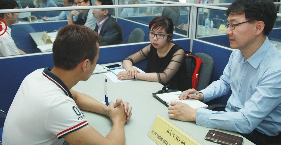 A group of people sitting at a table Description automatically generated with low confidence